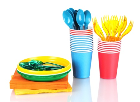 Bright plastic tableware and napkins isolated on white Stock Photo - 10499249