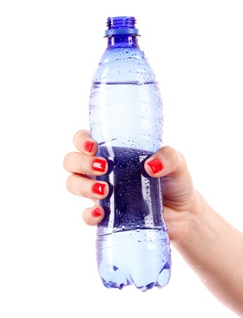 womans hand and bottle of water isolated on white photo