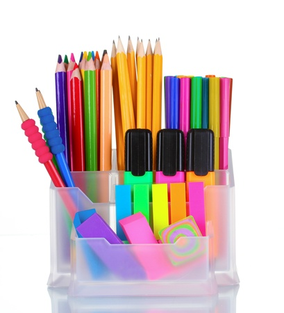 Bright pens, pencils and markers in holder isolated on white photo
