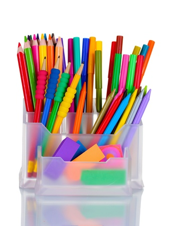 Bright pens, pencils and erasers in holder isolated on white photo