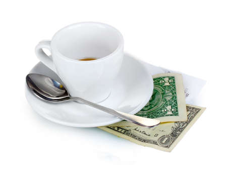 Empty cup of coffee with two dollars tip isolated on white photo