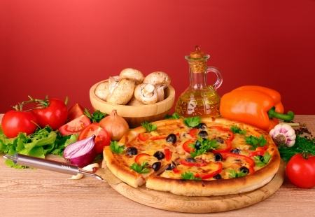pizza and vegetables on a red background Stock Photo - 10564769