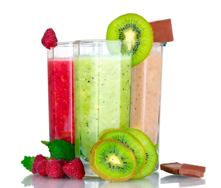 Delicious fruit smoothies and fruits isolated on white Stock Photo