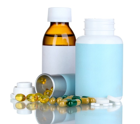 Medical bottles and pills isolated on white
