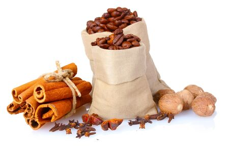 flavorings: cinnamon, coffee and nutmeg isolated on white