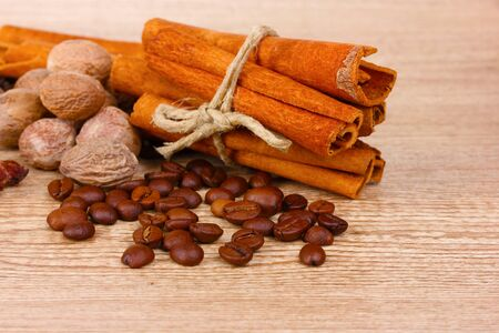 cinnamon and coffee on wooden background photo
