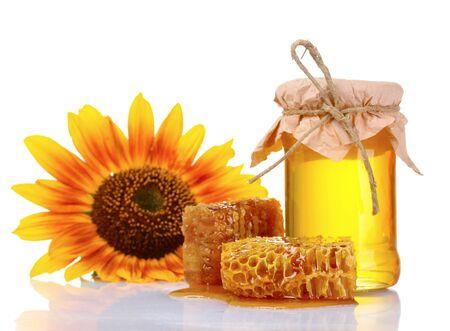 美しい櫛、蜂蜜、白で隔離されるひまわり 写真素材
