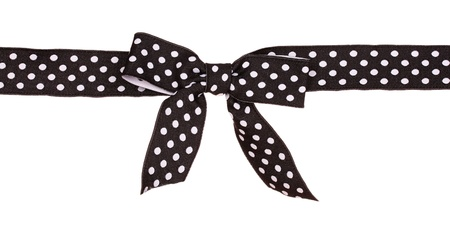bow knot: black ribbon with dots isolated on white Stock Photo