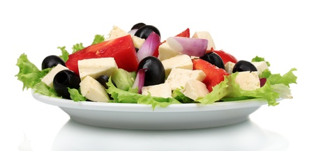 Tasty greek salad on plate isolated on white photo