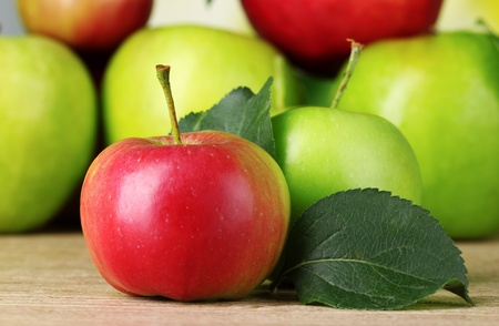 Many fresh organic apples on wooden table photo