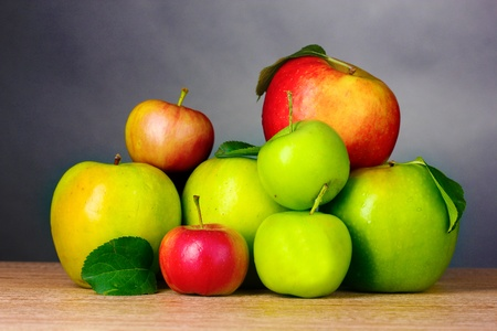Many fresh organic apples on wooden table on grey background Stock Photo - 10753989