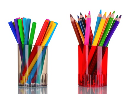 Bright markers and crayons in holders isolated on white Stock Photo - 10752662
