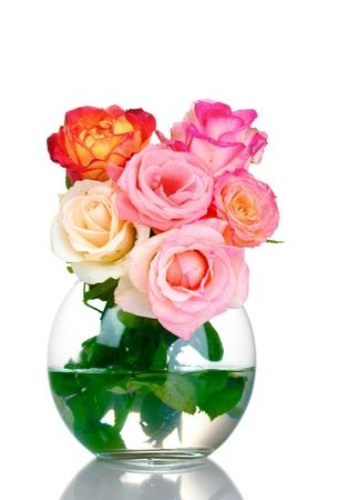 Beautiful bouquet of roses in transparent vase isolated on white