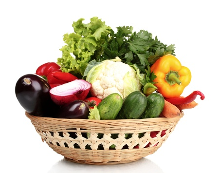 Fresh vegetables in basket isolated on white photo