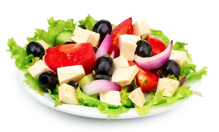 Tasty greek salad on plate isolated on white Stock Photo - 10817766