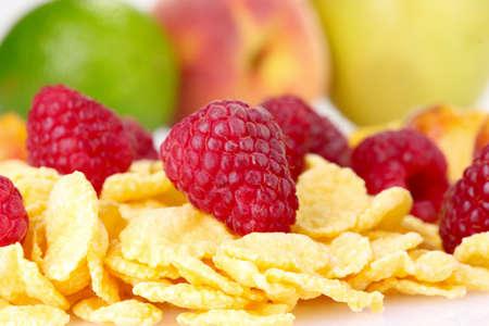 tasty cornflakes and fruit isolated on white Stock Photo - 10817557