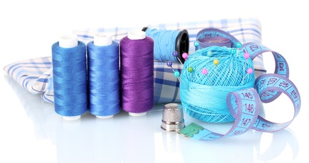 bright blue yarn, fabric and measuring tape isolated on white photo