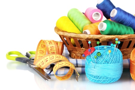 bright threads in basket, scissors and measuring tape isolated on white Stock Photo