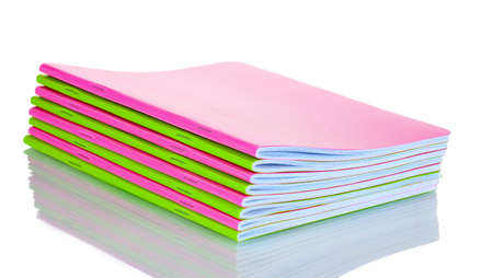 Green and pink notebooks isolated on white photo