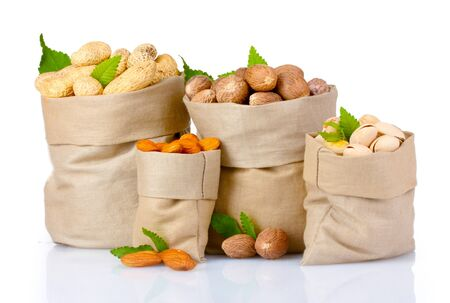variety of nuts in bags on white isolated Stock Photo - 10817553