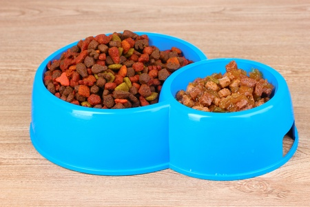 Dry cat food in bowls on wooden background Stock Photo - 10817546