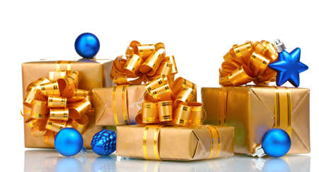 Beautiful gifts in gold packaging and Christmas balls isolated on white Stock Photo - 10817645