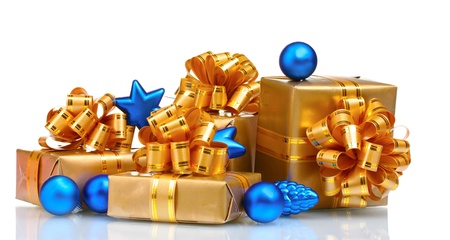 Beautiful gifts in gold packaging and Christmas balls isolated on white