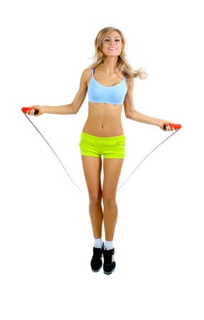 skipping: Beautiful sportsgirl with skipping rope isolated on white Stock Photo