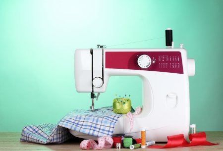 display machine: sewing machine and fabric on blue background