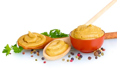 mustard: Mustard in bowl and spoons, spices and parsley isolated on white