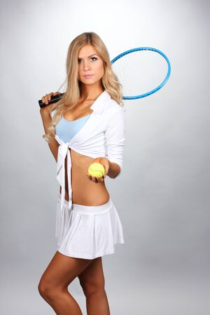 tennis skirt: Young girl with tennis racket isolated on white Stock Photo