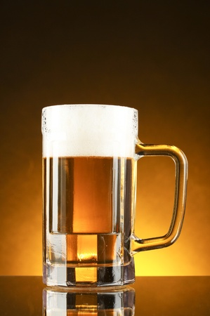 mug of beer on a yellow background Stock Photo - 10940599