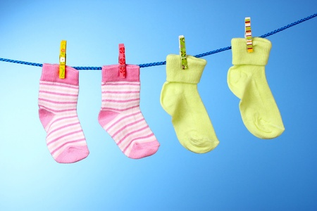 childrens socks on a rope on a blue background photo