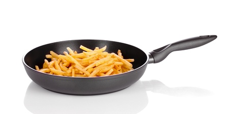 French fries in the pan isolated on white Stock Photo - 10940719