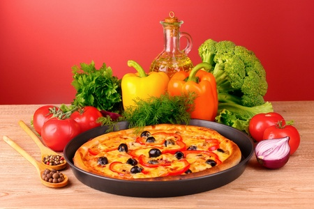 party tray: pizza and vegetables on a red background