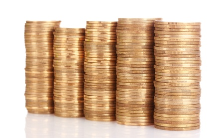 Many coins in column isolated on white photo