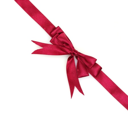 pink ribbons: red ribbon and bow isolated on white background