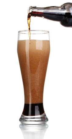 dark beer poured into a glass isolated on white Stock Photo - 11070258