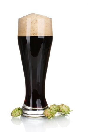 dark beer in a glass and green hop isolated on white photo
