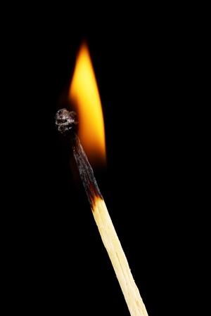 Burning match on black background Stock Photo - 11068732