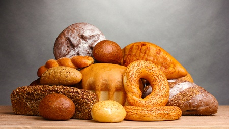 bakery products: delicious bread on wooden table on gray background Stock Photo