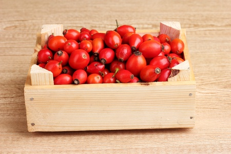 ripe briar in wooden box on wooden table on wooden background Stock Photo - 11069128