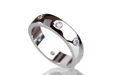 silver jewelry: beautiful ring with precious stones isolated on white