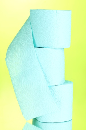 loo: blue rolls of toilet paper on green background