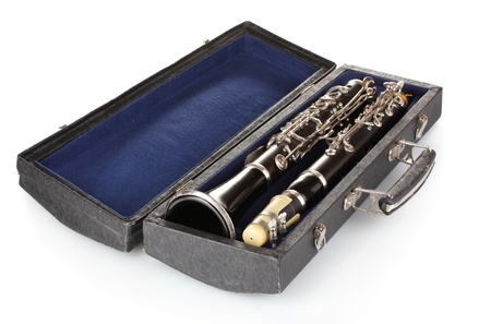 timbre: Antique clarinet in case isolated on white