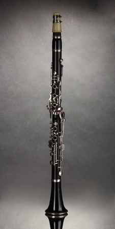 down beat: beautiful clarinet on a gray background