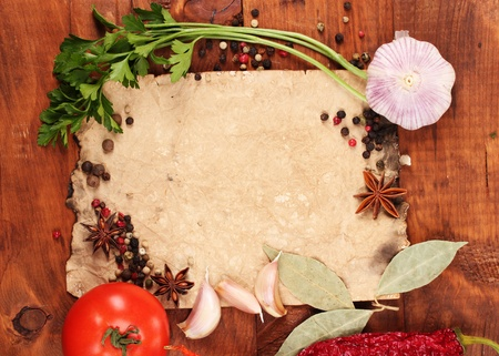 recipe background: old paper for recipes and spices on wooden table Stock Photo