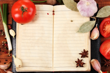 recipe book: notebook for recipes and spices on wooden table Stock Photo