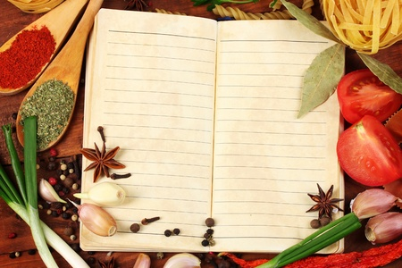 notebook for recipes and spices on wooden table photo