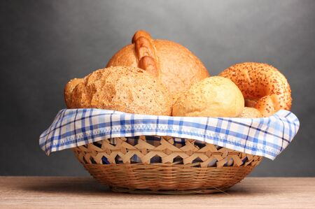 delicious bread in basket on wooden table on gray background Stock Photo - 11192903